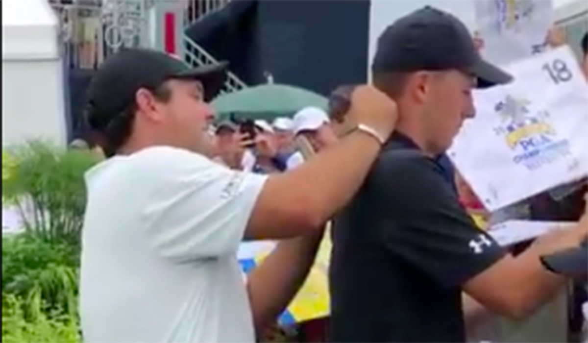 Watch Patrick Reed sign Jordan Spieth's neck at an autograph session at the PGA Championship