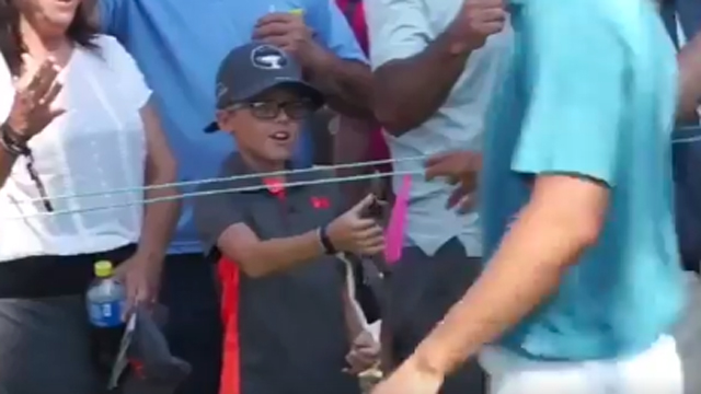 Young fan has adorable reaction to receiving golf ball from Jordan Spieth